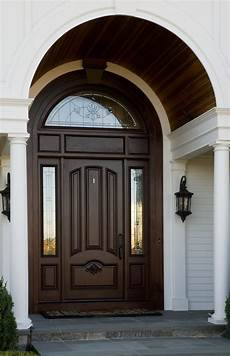 Arch Design Window And Door A Beautiful Wooden Arch Accentuates The Curved Window