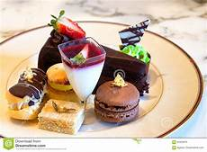 plate of fancy desserts including chocolate cake and