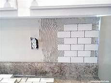 how to install tile backsplash kitchen how to install a backsplash the budget decorator