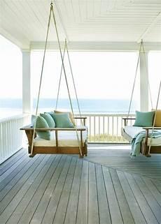 swinging sofa cottage porch