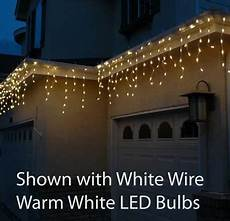 Led Vs Clear Christmas Lights Twinkle Warm White Led Icicle Lights On White Wire