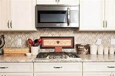 kitchen backsplash with cabinets kitchen tile backsplash ideas that are easy and inexpensive
