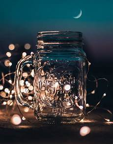 Fairy Lights In Glass Cylinder Shallow Focus Photograph Of Clear Glass Mason Jar With
