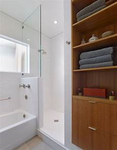 small bathroom custom linen cabinet shower and tub