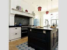 Open plan kitchen with black island and range cooker   Range cooker kitchen, Open plan kitchen