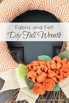 fabric and felt fall wreath with a touch of burlap ribbon