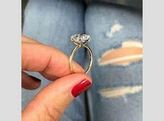 Cushion cut engagement ring with whisper thin yellow gold