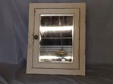 antique industrial recessed metal medicine cabinet beveled