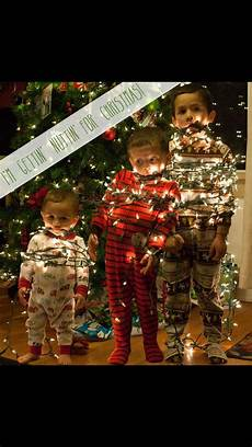 Baby Wrapped In Christmas Lights Photo Realistic Picture Of Kids Wrapped In Christmas Lights It