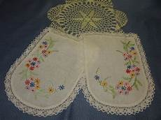 vintage embroidered doilies or sofa arm covers and