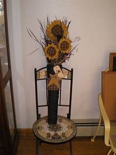 black primitive hanging basket with fabric sunflowers