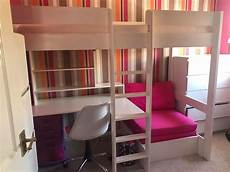 single bunk bed with desk and sofa bed chair underneath