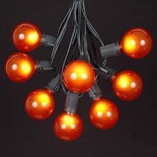 Orange Chasing Lights Orange Satin G50 Globe Outdoor String Light Set On Black