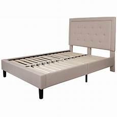 beige fabric upholstered platform bed frame with