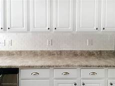 White Subway Tile Backsplash How To Install A Kitchen Backsplash The Best And Easiest