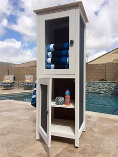 white poolside towel cabinet from benchmark cabinet