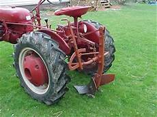 Middlebuster Plow On A 1950 Farmall Cub Tractorshed Com