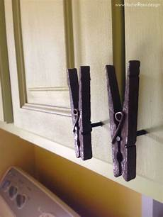 diy clothespin cabinet pulls laundry room diy cabinet