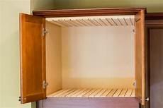 kitchen diy adding cookie sheet tray storage above the