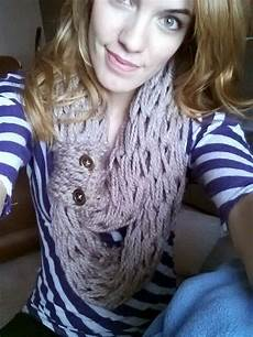 arm knitted the scarf and finger knitted the buttoned band