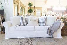 about white slipcovered sofa with and pets