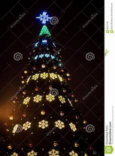 bright star christmas light tester a large christmas tree with bright garlands and star shine