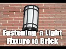 How To Attach Solar Lights To Brick Wall Fastening A Light To A Brick Wall With Sleeve Anchors