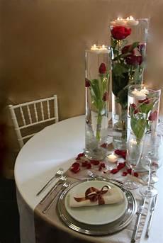 composizioni candele centrotavola con composizione a tre cilindri e