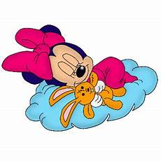 baby minnie mouse sleeping on blue pillow with teddy
