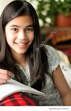 Younger Teens Young Girl Writing In Her Notebook Stock Image