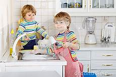 clothes for boys dishes two boy friends washing dishes in domestic