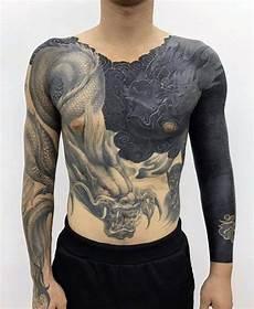Black And White Designs For Men 70 All Black Tattoos For Men Blackout Design Ideas