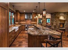 Rustic Kitchen with Ceramic Tile, Flush, Breakfast bar, L shaped, Flat panel cabinets, Pendant