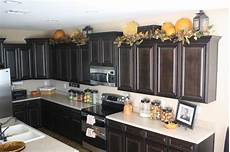 ideas for top of kitchen cabinets on top of kitchen cabinet decorating ideas home interior