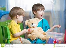 Children Play Doctor Children Play Doctor With Plush Toy Stock Photo Image Of
