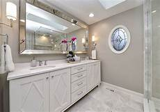 One Light Fixture Over Two Mirrors Bathroom Mirrors That Are The Perfect Final Touch Home