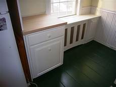 handmade kitchen cabinet and radiator cover by blair