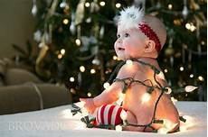 Baby Wrapped In Christmas Lights Photo Baby Wrapped In Christmas Lights Photos Baby