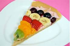 the fruit pizza pennies on a platter serving
