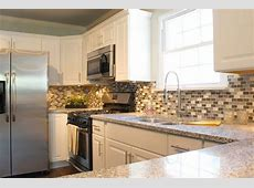 """Our white cabinets with """"salt and pepper"""" granite countertops and stainless steel appliances. in"""