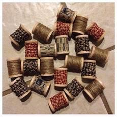 primitive decor wooden spools with homespun fabric