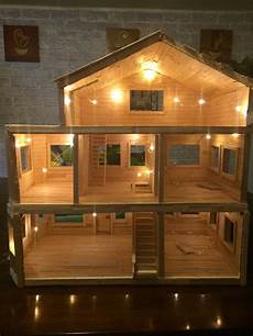 dollhouse made entirely from popsicle sticks doll