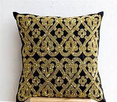 black geometric throw pillows bead and disc detail