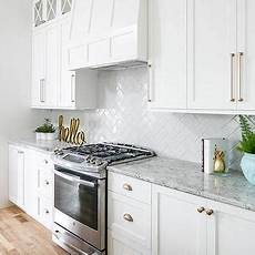 white shaker cabinets gold pulls design ideas