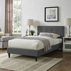 tufted gray fabric upholstered platform bed frame