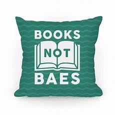 this book lover pillow features a book and the words