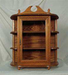 oak hanging wall mounted curio cabinet with glass door 2