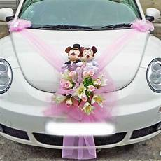 wedding car decoration tulle with floral bouquet topped