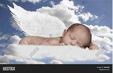 baby engel baby infant in clouds with wings stock photo stock