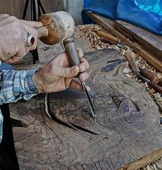 Carving Werkzeugfemor by Wood Carving Carver With Chisel And Hammer Stock Photo